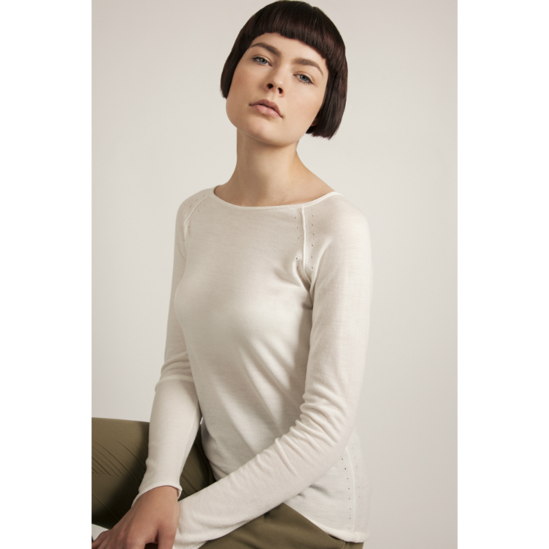 Model wears ivory jumper in merino wool