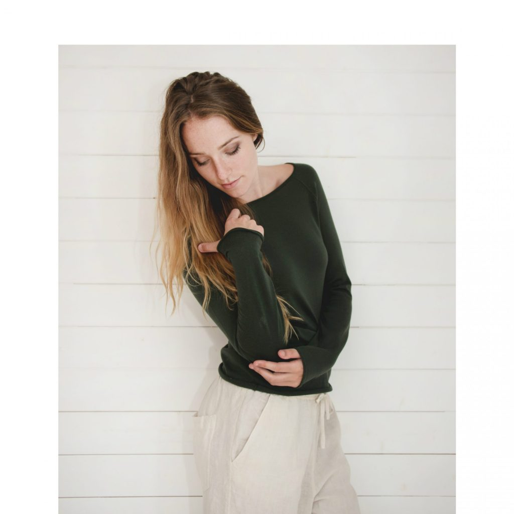 Model wears Phoebe Merino Top in Forest. Knitwear from Flock by nature